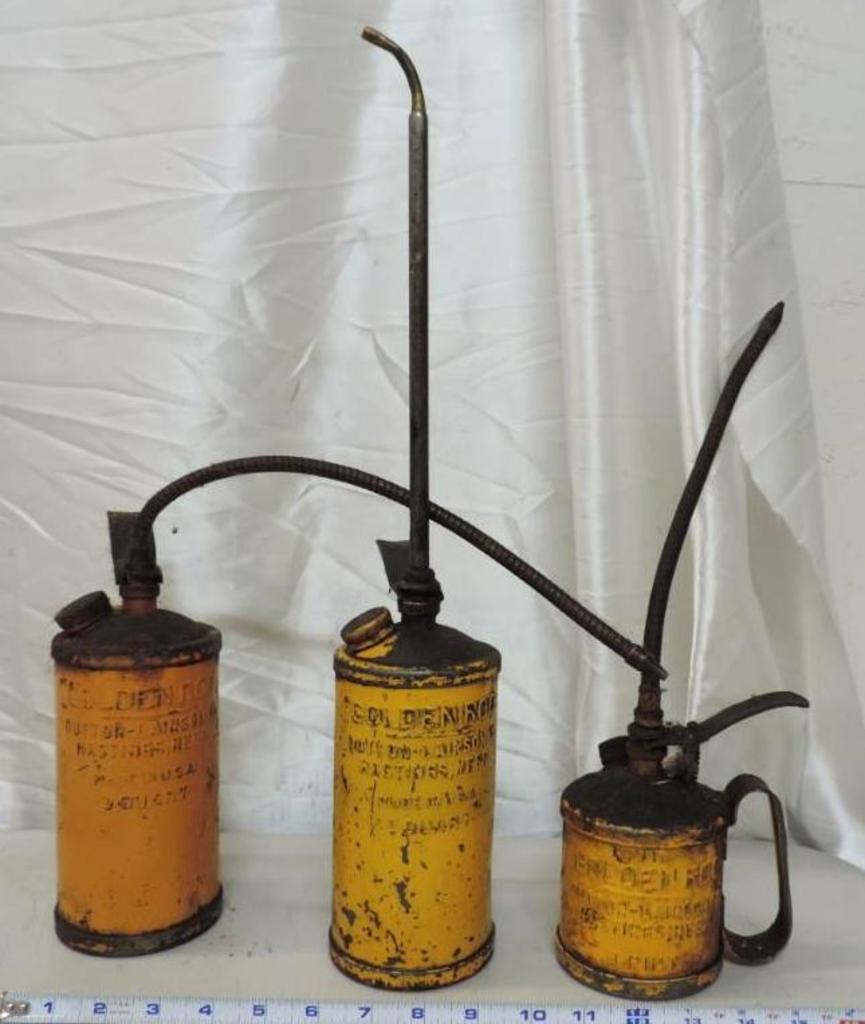 3 Golden Rod oil cans.