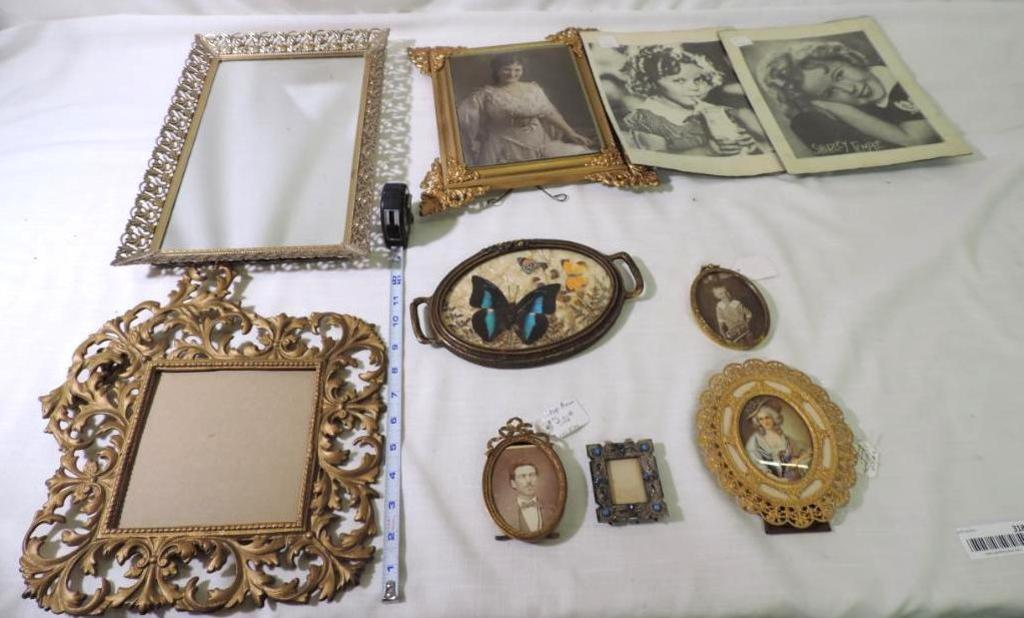 Six antique metal picture frames, wood framed picture, framed butterfly and 2 Shirley Temple prints.