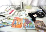 Nintendo Wii console with 2 controllers, 2 wheels, games and more.
