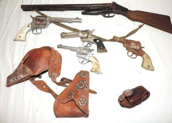 Antique cap guns assortment.