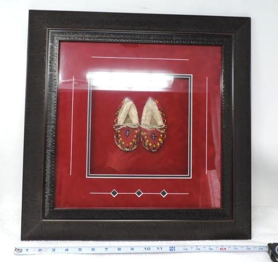 Tracy's studio framed beaded moccasins.