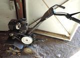 Craftsman 5HP front tine tiller.