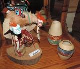Kachina doll with two southwestern vases.