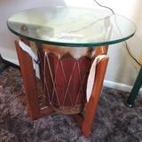 Singed drum glass top side table.