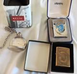 Two Zippo lighters and a relic pocket watch.