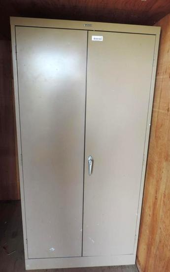 Three Anderson Hickey Co metal cabinets.
