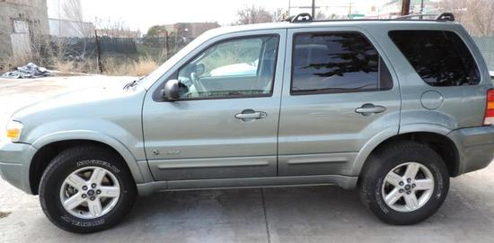 2006 Ford Escape Hybrid with 108k miles.