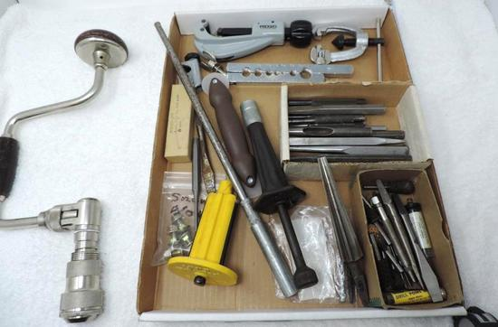 Rigid pipe cutter and tool assortment.