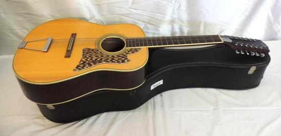 Vintage Kingston guitar with case.