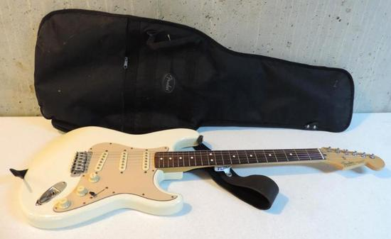 Fender Stratocaster electric guitar with soft case.