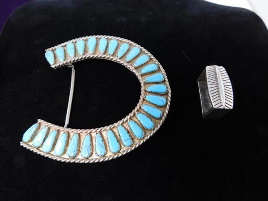 Turquoise and silver horse shoe belt buckle
