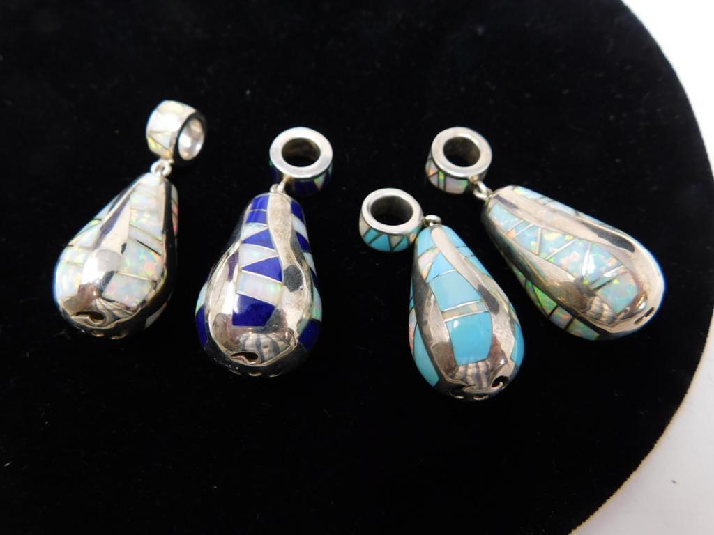 Four Sterling pendants