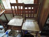 4 ornate antique oak chairs.
