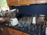 Osterizer blender and glassware.