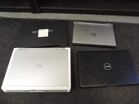 Four Dell laptops for parts or repair.