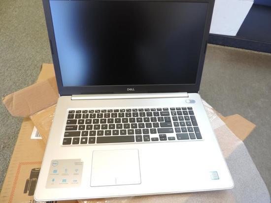 Silver Dell model P35E laptop computer.