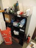 Shelving unit loaded with office supplies.