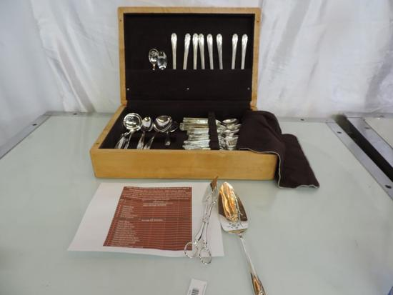 Rogers Bothers IS Daffodil flatware set with birch wood case.