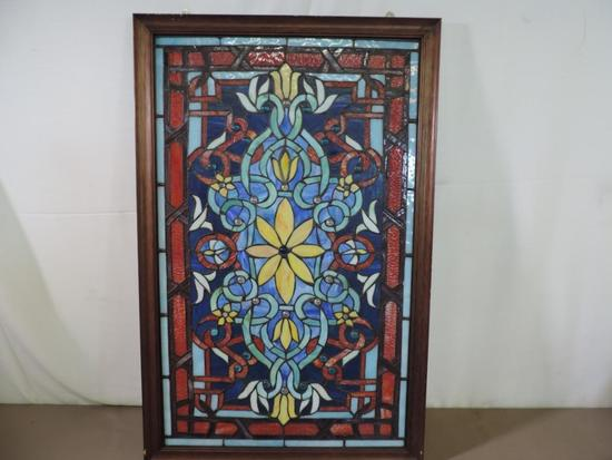 Gorgeous framed stained glass window.