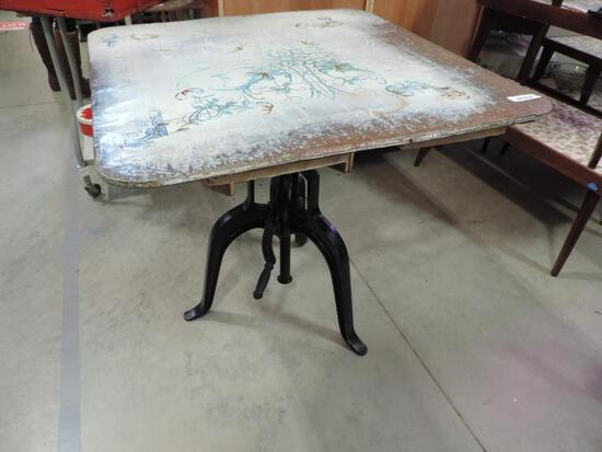 Wabash Delft Enamel top adjustable height table with cast iron base.