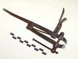 Miniature working blacksmith leg vise.