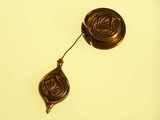 Decorative cast bronze plumb bob w/ string reel.
