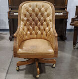 Button Tufted Rustic Leather Swivel Arm Chair